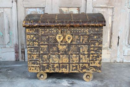 Tribal Dowry Chest on Wheels with faded ochre paint